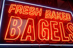 "A colored photograph of a Neon Sign in red with white-outlined lettering,saying ""Fresh Baked Bagels"". Is the Rapture a good thing?"