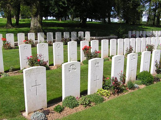 A colored photograph of rows of white headstones at a war cemetery with trees in the background. Is the Rapture a good thing?