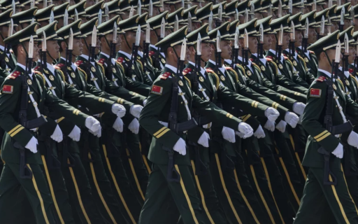 Colored photograph of row upon row of robotic and precise Chinese soldiers of identical height in dark green uniform with gold stripes, white gloves and peaked caps and assault rifles with polished bayonets. 200 million horsemen.