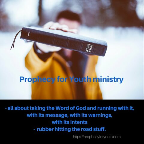 "Colored photograph of young man holding a bible in front of him. Man wearing a yellow jacket and blue shirt. Words in blue: ""Prophecy for Youth Ministry. All about taking the Word of God and running with it, with its message, with its warnings, with its intent - 'rubber hitting the road' stuff. Stepping on Ten Toes."